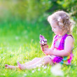 Funny girl eating ice cream in the garden — Stock Photo #48041561