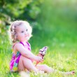 Funny girl eating ice cream in the garden — Stock Photo