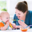 Baby boy eating his first solid food — Stock Photo #48042143