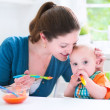 Baby boy eating his first solid food — Stock Photo #48042159