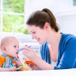 Baby boy eating his first solid food — Stock Photo #48042165