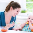 Baby boy eating his first solid food — Stock Photo