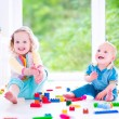 Brother and sister playing with colorful blocks — Stock Photo #48042899