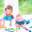 Brother and sister playing with colorful blocks — Stock Photo #48043023