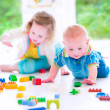 Brother and sister playing with colorful blocks — Stock Photo #48043041
