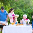 Big family grilling meat for lunch — Stock Photo #48043045