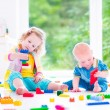 Brother and sister playing with colorful blocks — Stock Photo #48043051