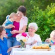Big family grilling meat for lunch — Stock Photo #48043089