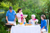 Big family grilling meat for lunch — Stock Photo