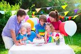Happy family at a birthday party — Stock Photo