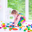 Little girl playing with blocks — Stock Photo #48741771