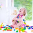 Little girl playing with blocks — Stock Photo #48741781