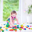 Little girl playing with blocks — Stock Photo #48741789