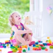 Little girl playing with blocks — Stock Photo #48741817