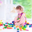 Little girl playing with blocks — Stock Photo #48741823