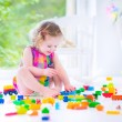 Little girl playing with blocks — Stock Photo