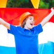 Dutch football fan, little boy cheering — Stock Photo #48966311