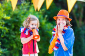 Two kids Dutch football supporters — Zdjęcie stockowe