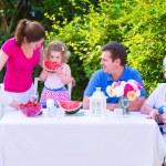 Family eating fruit in the garden — Stock Photo #49279203
