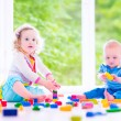 Brother and sister playing with colorful blocks — Stock Photo #49279225