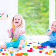 Brother and sister playing with colorful blocks — Stock Photo #49279399