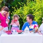 Family eating fruit in the garden — Stock Photo #49279417