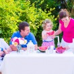 Family eating fruit in the garden — Stock Photo #49279455