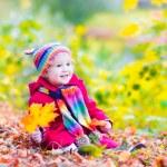 Little girl having fun in an autumn park — Stock Photo #49279629
