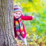 Little girl having fun in an autumn park — Stock Photo #49279653