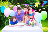 Happy family at birthday party — Foto Stock