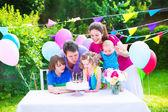 Happy family at birthday party — Stock Photo