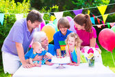 Happy family at a birthday party — Photo