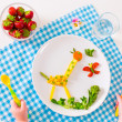 Child's hand and healthy vegetable lunch — Stock Photo #49606857