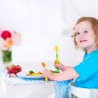 Little girl eating salad for lunch — Stock Photo #49607033