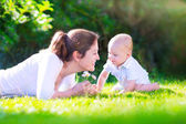 Mother and baby in the garden — Stock Photo