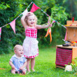 Little kids playing with toy kitchen in the garden — Stock Photo #51193461