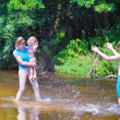 Family enjoying hot day on a river — Stock Photo #51342799
