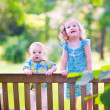Brother and sister on a park bench — Stock Photo #51342893