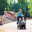 Woman with a double stroller — Stock Photo #51343261