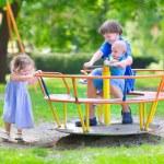 Three kids on a swing — Stock Photo #51343455