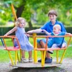 Three kids on a swing — Stock Photo #51343465
