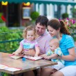 Family at an outside cafe — Stock Photo #51343871