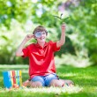 Happy child with magnifying glass — Stock Photo #51344095