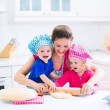 Mother and kids baking a pie — Stock Photo #51344283