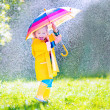 Funny toddler with umbrella playing in the rain — Stock Photo #51344453