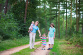 Family hiking in a pine wood — Стоковое фото