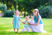 Young family in the garden — Stock Photo