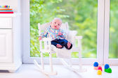 Baby boy n a rocking chair — Stock Photo