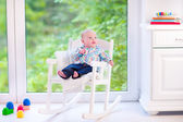 Baby boy in a rocking chair — Stock Photo