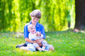 Brothers playing in the garden — Stock Photo